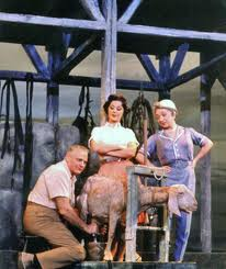 "Robert Weede (milking a goat!), Mimi Benzell and Molly Picon in ""Milk and Honey."""