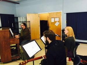 In rehearsal, Steven Alper (at piano), with Eli Zoller and Megan Loomis.