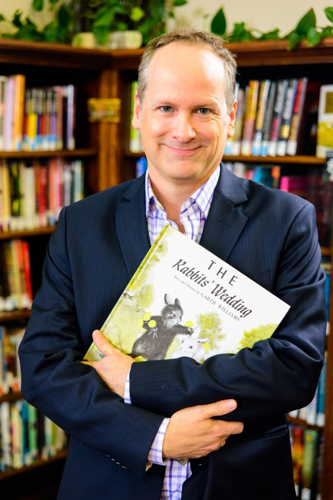 """Kenneth Jones with a copy of a controversial children's book that inspired """"Alabama Story."""" (Photo by Alex Weisman)"""